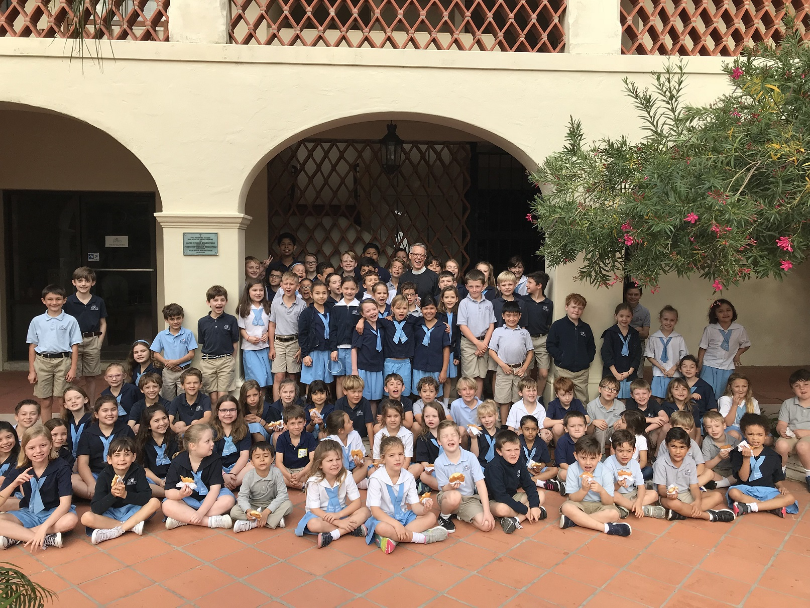 Lower school group photo of kids in courtyard